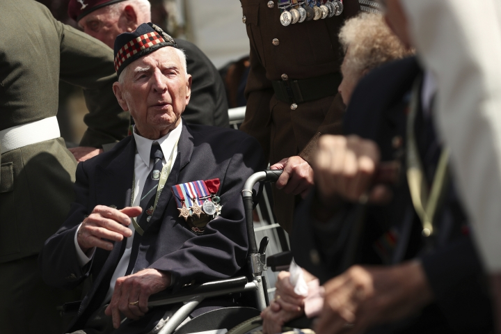 A World War II veteran arrives to the Bayeux War Cemetery for a ceremony to mark the 75th anniversary of D-Day in Bayeux, Normandy, France, Thursday, June 6, 2019. World leaders gathered Thursday in France to mark the 75th anniversary of the D-Day landings.(AP Photo/Francisco Seco)