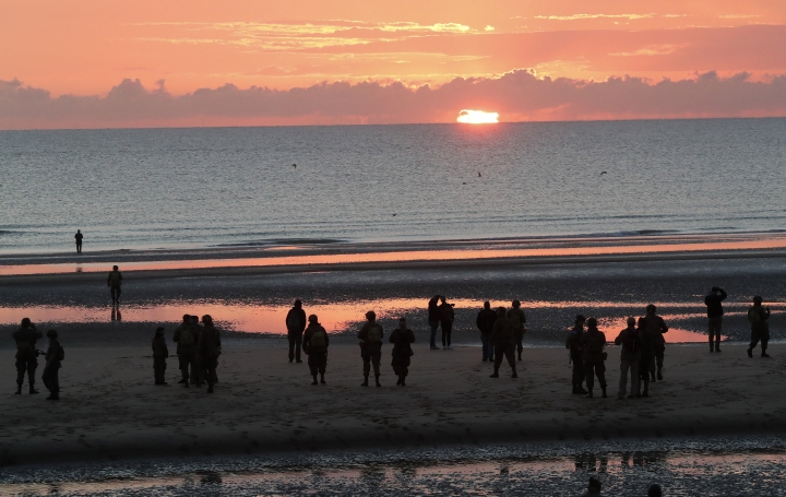 World War II reenactors stand on Omaha Beach, in Normandy, France, at dawn on Thursday, June 6, 2019 during commemorations of the 75th anniversary of D-Day. (AP Photo/Thibault Camus)