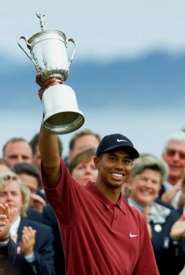 FILE - In this June 18, 2000, file photo, Tiger Woods holds up the trophy after winning the 100th U.S. Open Golf Championship at the Pebble Beach Golf Links in Pebble Beach, Calif. Woods won by a record 15 strokes. (AP Photo/Eric Risberg, File)