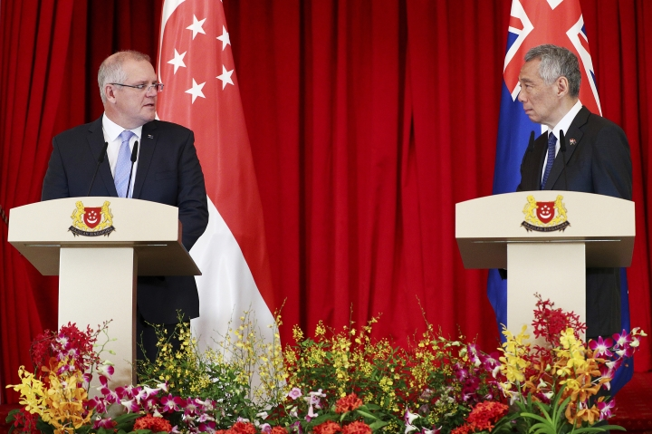 Australian Prime Minister Scott Morrison, left, speaks with his Singaporean counterpart Lee Hsien Loong during a joint press conference at the Istana or Presidential Palace in Singapore, Friday, June 7, 2019. (AP Photo/Yong Teck Lim)