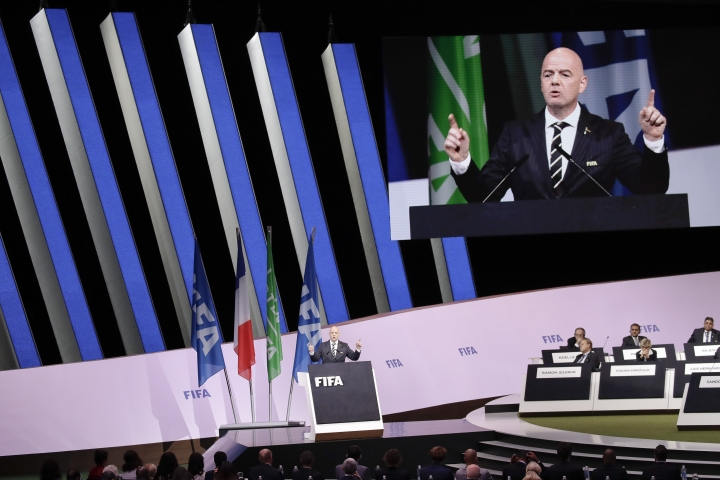 "FIFA President Gianni Infantino delivers his speech during the 69th FIFA congress in Paris, Wednesday, June 5, 2019. Hours ahead of his re-election unopposed, Infantino tells 211 member federations that today ""nobody talks about crisis."" (AP Photo/Alessandra Tarantino)"