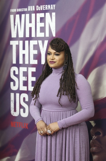 "FILE- In this May 20, 2019 file photo, director Ava DuVernay attends the world premiere of her film ""When They See Us,"" at the Apollo in New York. Linda Fairstein, a former prosecutor in the Central Park Five case, has resigned from at least two nonprofit boards as backlash intensified following the release of the Netflix miniseries that dramatizes the events surrounding the trial. (Photo by Donald Traill/Invision/AP, File)"