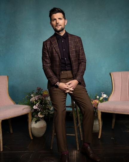 """This photo provided by HBO shows Adam Scott. Scott plays Ed Mackenzie, husband to Reese Witherspoon's Madeline, in the HBO series """"Big Little Lies"""" returning for its second season on Sunday, June 9, 2019. (Griffin Lipson/HBO via AP)"""