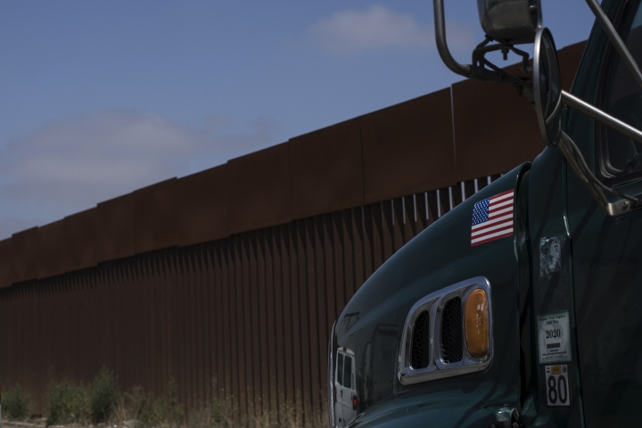 A truck waits in line to cross into the United States at the border in Tijuana, Mexico, Friday, June 7, 2019. Companies have been rushing to ship as many goods as possible out of Mexico to get ahead of possible tariffs threatened by President Donald Trump, hurriedly sending cars, appliances and construction materials across the border to beat Monday's deadline. (AP Photo/Hans-Maximo Musielik)
