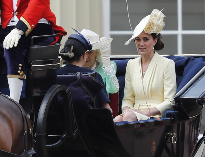 Britain's Camilla, the Duchess of Cornwall, left, Kate, the Duchess of Cambridge and Meghan, the Duchess of Sussex ride in a carriage to attend the annual Trooping the Colour Ceremony in London, Saturday, June 8, 2019. Trooping the Colour is the Queen's Birthday Parade and one of the nation's most impressive and iconic annual events attended by almost every member of the Royal Family. (AP Photo/Frank Augstein)