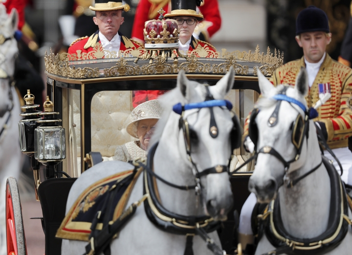 Britain's Queen Elizabeth rides in a carriage to attend the annual Trooping the Colour Ceremony in London, Saturday, June 8, 2019. Trooping the Colour is the Queen's Birthday Parade and one of the nation's most impressive and iconic annual events attended by almost every member of the Royal Family. (AP Photo/Frank Augstein)