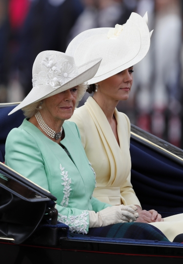 Britain's Camilla, the Duchess of Cornwall, left, Kate, and the Duchess of Cambridge ride in a carriage to attend the annual Trooping the Colour Ceremony in London, Saturday, June 8, 2019. Trooping the Colour is the Queen's Birthday Parade and one of the nation's most impressive and iconic annual events attended by almost every member of the Royal Family. (AP Photo/Frank Augstein)