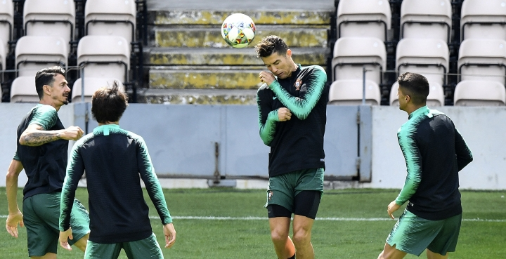 Portugal's Cristiano Ronaldo heads the ball during a training session at the Bessa stadium in Porto, Portugal, Saturday, June 8, 2019. Portugal will play Netherlands in the UEFA Nations League final soccer match on Sunday. (AP Photo/Martin Meissner)