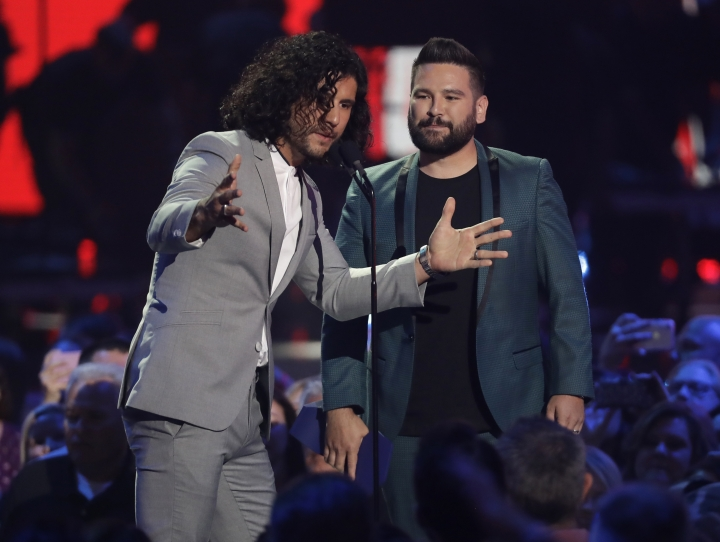 "Dan Smyers, left, and Shay Mooney, of Dan + Shay, accept the award for duo video of the year for ""Speechless"" at the CMT Music Awards on Wednesday, June 5, 2019, at the Bridgestone Arena in Nashville, Tenn. (AP Photo/Mark Humphrey)"