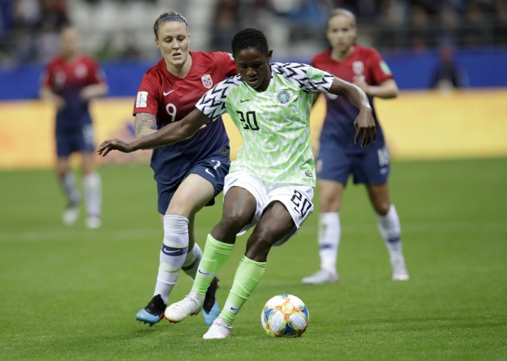 Nigeria's Chidinma Okeke takes the ball away from Norway's Isabell Herlovsen, left, during the Women's World Cup Group A soccer match between Norway and Nigeria at stadium Auguste Delaune in Reims, France, Saturday, June 8, 2019. (AP Photo/Alessandra Tarantino)