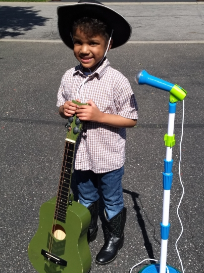 "This undated photo provided by Sheletta Brundidge shows her son Daniel. Lil Nas X has found huge success with the song, ""Old Town Road."" Brundidge tweeted Tuesday, June 4, 2019, that she filmed Daniel, who is autistic and mostly nonverbal, humming the tune and then singing the lyrics. Now, she says therapists are using the music in his sessions. (Sheletta Brundidge via AP)"