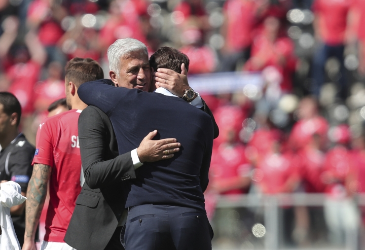 Switzerland coach Vladimir Petkovic, left, embraces with England manager Gareth Southgate at the end the UEFA Nations League third place soccer match between Switzerland and England at the D. Afonso Henriques stadium in Guimaraes, Portugal, Sunday, June 9, 2019. (AP Photo/Luis Vieira)