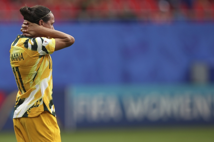 Australia's Lisa De Vanna holds her head after the Women's World Cup Group C soccer match between Australia and Italy at the Stade du Hainaut in Valenciennes, Sunday, June 9, 2019. (AP Photo/Francisco Seco)