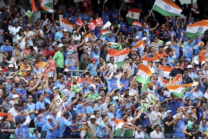 Indian fans celebrate a boundary by India's Hardik Pandya during the Cricket World Cup match between Australia and India at The Oval in London, Sunday, June 9, 2019. (AP Photo/Aijaz Rahi)