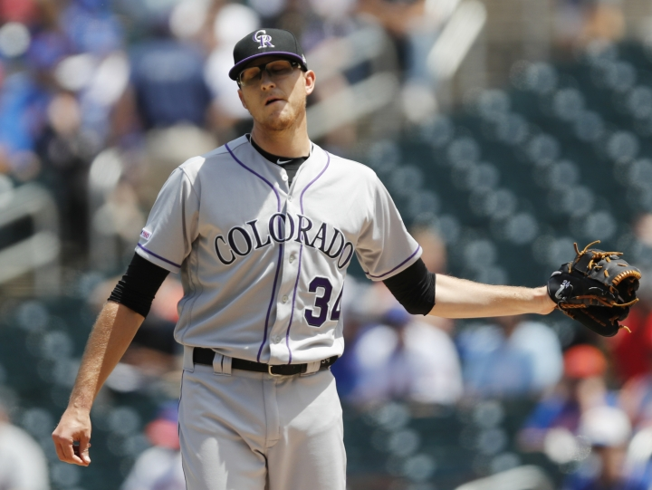 Colorado Rockies starting pitcher Jeff Hoffman reacts after allowing a three-run, home run to New York Mets' Todd Frazier during the first inning of a baseball game, Sunday, June 9, 2019, in New York. (AP Photo/Kathy Willens)