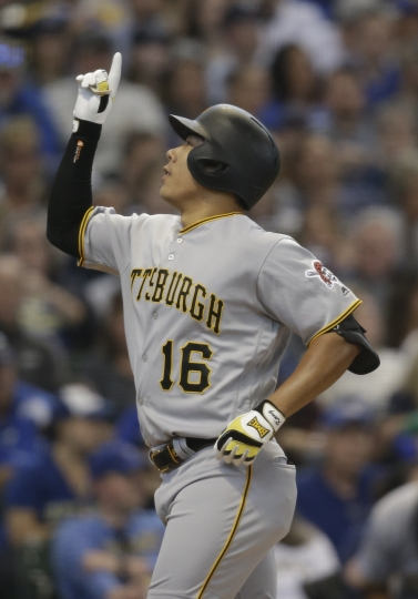 Pittsburgh Pirates' Jung Ho Kang reacts after his two-run home run against the Milwaukee Brewers during the second inning of a baseball game Sunday, June 9, 2019, in Milwaukee. (AP Photo/Jeffrey Phelps)
