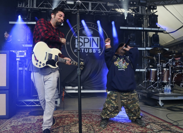 FILE - In this March 18, 2016, photo Bushwick Bill, right, joins Deftones' Chino Moreno onstage at the SPIN Party at Stubb's during the South by Southwest Music Festival in Austin, Texas. A publicist for rapper Bushwick Bill says the founder of the iconic Houston rap group the Geto Boys has died. Bill's publicist, Dawn P., told The Associated Press that the rapper died Sunday, June 9, 2019, at a Colorado hospital. (Photo by Jack Plunkett/Invision/AP, File)