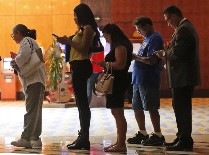 In this Tuesday, June 4, 2019 photo, job applicants wait in line at the Seminole Hard Rock Hotel & Casino Hollywood during a job fair in Hollywood, Fla. On Monday, June 10, the Labor Department reports on job openings and labor turnover for April. (AP Photo/Wilfredo Lee)