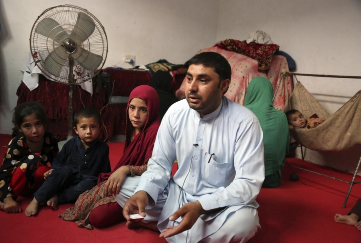 In this Thursday, May 30, 2019 photo, Farmanullah Shirzad who fled his village in Nangarhar province with his family in late April as Islamic State group fighters swept through the area, gives an interview to The Associate Press in their temporary home in Jalalabad, Afghanistan. The Islamic State group has lost its caliphate in Syria and Iraq, but in the forbidding mountains of northeastern Afghanistan the group is expanding its footprint, recruiting new fighters and plotting attacks in the United States and other Western countries. (AP Photo/Rahmat Gul)
