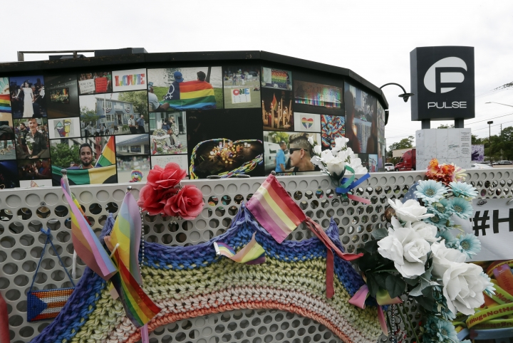 An outside view of the Pulse nightclub temporary memorial is seen before a news conference to introduce legislation that would designate the Pulse nightclub site as a national memorial, Monday, June 10, 2019, in Orlando, Fla. (AP Photo/John Raoux)