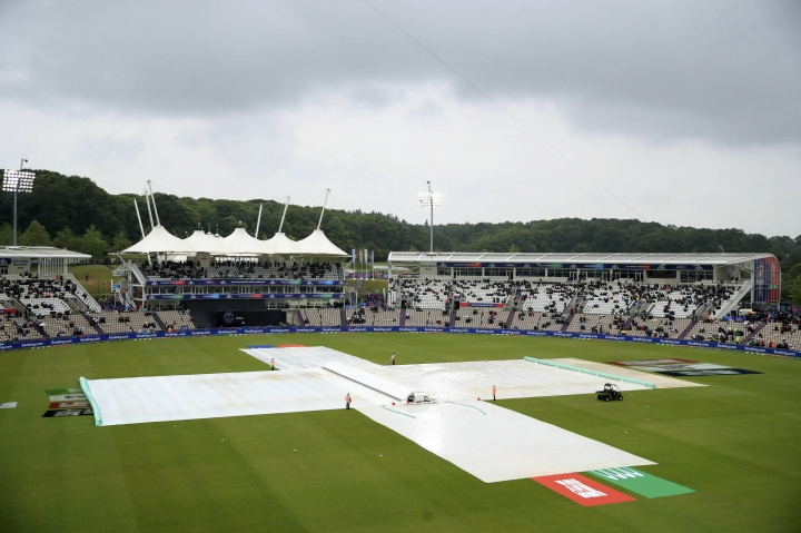 The covers go on as rain stops play during the Cricket World Cup group stage match between South Africa and the West Indies at the Hampshire Bowl, Southampton, England, Monday June 10, 2019. (Adam Davy/PA via AP)