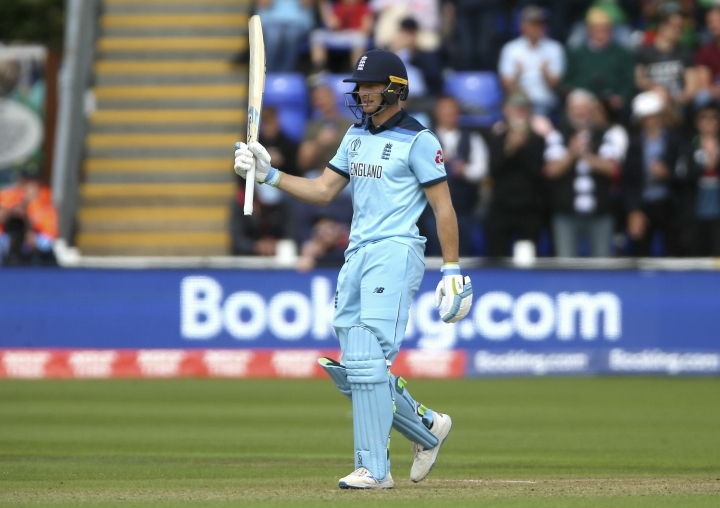 England's Jos Buttler celebrates reaching a half century during the ICC Cricket World Cup group stage match between England and Bangladesh at the Cardiff Wales Stadium in Cardiff, Wales, Saturday, June 8, 2019. (Nigel French/PA via AP)