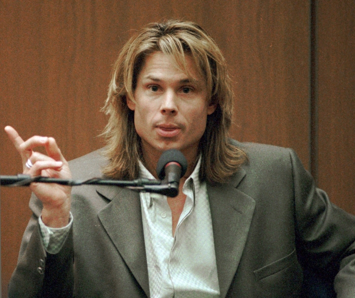 """FILE - In this March 21, 1995, file photo, Brian """"Kato"""" Kaelin testifies under direct examination during the O.J. Simpson double-murder trial in Los Angeles. Kaelin, a struggling actor living in a guest house on Simpson's property, testified he heard a bump during the night of the murders and went outside to find Simpson in the yard, something prosecutors say showed Simpson was sneaking back home after the killings. (John McCoy/Los Angeles Daily News via AP, Pool, File)"""