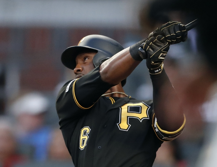 Pittsburgh Pirates' Starling Marte (6) follows through on a three-run home run in the third inning of a baseball game against the Atlanta Braves, Monday, June 10, 2019, in Atlanta. (AP Photo/John Bazemore)