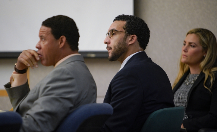 Sitting in Superior Court in Vista, Kellen Winslow, Jr., is flanked by two of his three defense attorneys, Brian Watkins, left, and Elizabeth Bahr, right, as he listens to closing arguments to jury from Deputy District Attorney, Dan Owens on Tuesday, June 4, 2019, in Vista, Calif. (Nelvin C. Cepeda/The San Diego Union-Tribune via AP, Pool)