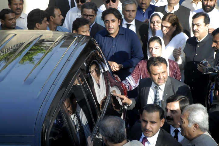 Pakistan's opposition leader Bilawal Bhutto Zardari, in blue shirt center, sees off his father Asif Ali Zardari, former President of Pakistan with other family members, at his residence in Islamabad, Pakistan, Monday, June 10, 2019. Pakistan's anti-graft body on Monday arrested Zardari, widower of assassinated ex-Premier Benazir Bhutto, in a multi-million dollar money laundering case that has shaken the country. (AP Photo/B.K. Bangash)