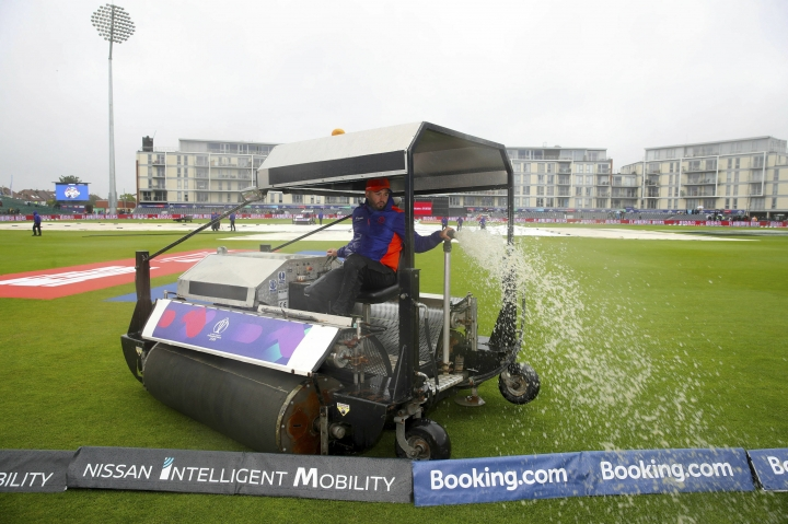 Ground staff clear water from the pitch at the ICC Cricket World Cup group stage match at the County Ground in Bristol. England, Tuesday June 11, 2019. Bangladesh is scheduled to play Sri Lanka Tuesday but there has not been any play yet, as much of England is suffering from unseasonal downpours. (Nick Potts/PA via AP)