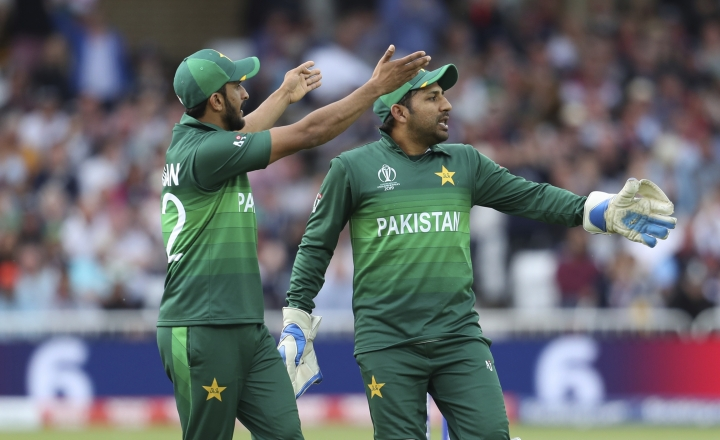 Pakistan's captain Sarfaraz Ahmed, right, and Hasan Ali gesture to their teammates during the Cricket World Cup match between England and Pakistan at Trent Bridge in Nottingham, Monday, June 3, 2019. (AP Photo/Rui Vieira)