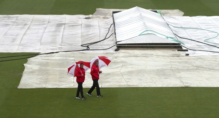 Umpires Richard Illingworth, right, and Richard Kettleborough inspect the field of play as it continues to rain at the ICC Cricket World Cup group stage match at the County Ground in Bristol. England, Tuesday June 11, 2019. Bangladesh is scheduled to play Sri Lanka Tuesday but there has not been any play yet, as much of England is suffering from unseasonal downpours. (Nick Potts/PA via AP)
