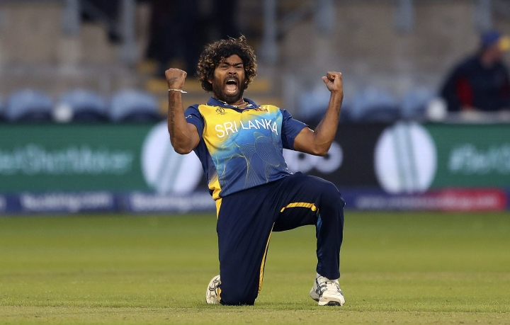 Sri Lanka's Lasith Malinga celebrates taking the wicket of Afghanistan's Hamid Hassan during the Cricket World Cup group stage match between Sri Lanka and Afghanistan at the Cardiff Stadium, Wales, Tuesday June 4, 2019. (David Davies/PA via AP)