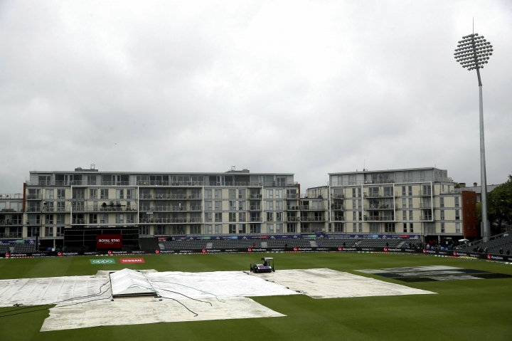 Rain covers on the pitch as rain stops play during the World Cup cricket match between Bangladesh and Sri Lanka at Bristol County Ground, south west England, Tuesday June 11, 2019. (Nick Potts/PA via AP)