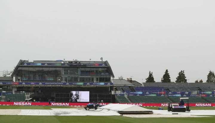 Ground staff work to clear water off the outfield prior to the Cricket World Cup match between Pakistan and Sri Lanka, at Bristol County Ground, in Bristol, England, Friday June 7, 2019. (David Davies/PA via AP)