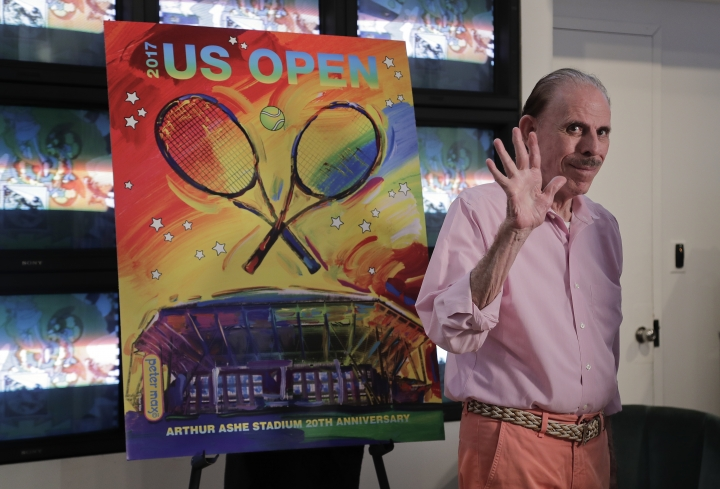 CORRECTS MARY MAX'S AGE TO 52, NOT 53 - FILE - In this June 14, 2017, file photo, artist Peter Max acknowledges applause during the unveiling of the theme art he created for the 2017 U.S. Open tennis tournament in New York. Authorities say Mary Max, 52, the wife of the artist Peter Max, was found dead Sunday, June 9, 2019, in New York, of a suspected suicide amid a family fight over her husband's work. Her death comes two weeks after The New York Times published a story detailing legal battles over the work of Peter Max, a prolific creator of colorful, psychedelic art who is now living with dementia at age 81. (AP Photo/Julie Jacobson, File)