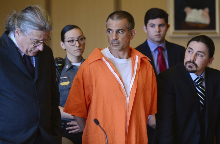 Fotis Dulos and his legal team including Norm Pattis, left, stand during a hearing at Stamford Superior Court, Tuesday, June 11, 2019 in Stamford, Conn. Fotis Dulos, and his girlfriend, Michelle Troconis, have been charged with evidence tampering and hindering prosecution in the disappearance of his wife Jennifer Dulos. The mother of five has has been missing since May 24. (Erik Trautmann/Hearst Connecticut Media via AP, Pool)