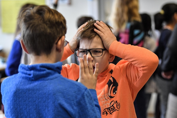 Young pupils during a role play lesson in social media and internet at a comprehensive school in Essen, Germany, Monday, March 18, 2019. Experts and teachers say that peer projects in which teenagers teach younger school mates how to deal with digital stress like constant messaging or cyber-bullying have proven to be especially successful.(AP Photo/Martin Meissner)