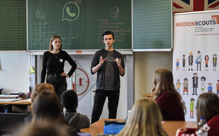 Senior students and media scouts Leon Zielinski, right, and Chantal Hueben teach younger pupils during a lesson in social media and internet at a comprehensive school in Essen, Germany, Monday, March 18, 2019. Experts and teachers say that peer projects in which teenagers teach younger school mates how to deal with digital stress like constant messaging or cyber-bullying have proven to be especially successful. (AP Photo/Martin Meissner)
