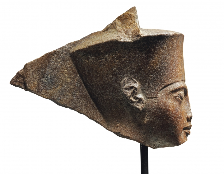 This image released by Christie's on Tuesday, June 11, 2019, shows a 3,000-year-old stone sculpture of the famed boy pharaoh Tutankhamun at Christie's in London. Egypt is trying to halt the auction of the sculpture of Tutankhamun at Christie's in London. The Foreign Ministry issued a statement late on Monday saying Egyptian authorities demand the auction house provide documents proving the artifact's ownership. (Christie's via AP)