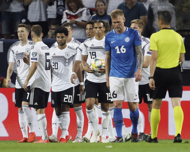 Germany's players celebrate their side's sixth goal during a Group C soccer qualifying match between Germany and Estonia in Mainz, Germany, Tuesday, June 11, 2019. (AP Photo/Michael Probst)