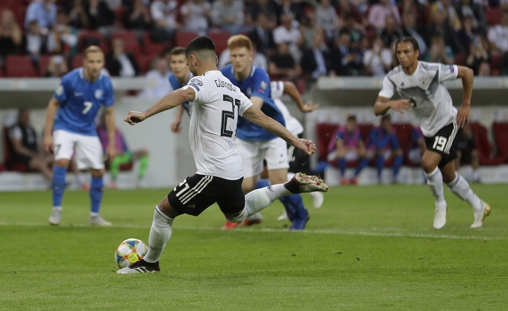 Germany's Ilkay Gundogan scores his side's fourth goal by penalty during a Group C soccer qualifying match between Germany and Estonia in Mainz, Germany, Tuesday, June 11, 2019. (AP Photo/Michael Probst)