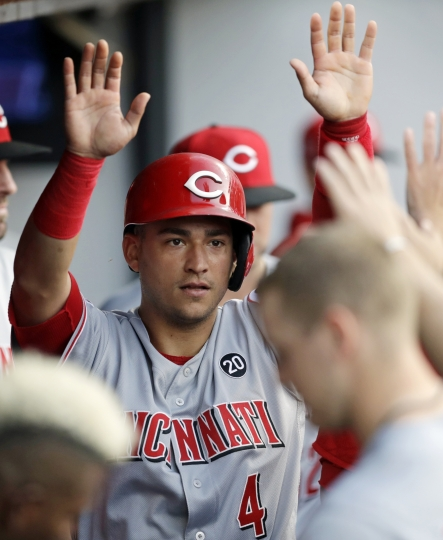 Cincinnati Reds' Jose Iglesias celebrates in the dugout after scoring on Nick Senzel's double in the fifth inning during a baseball game against the Cleveland Indians, Tuesday, June 11, 2019, in Cleveland. (AP Photo/Tony Dejak)