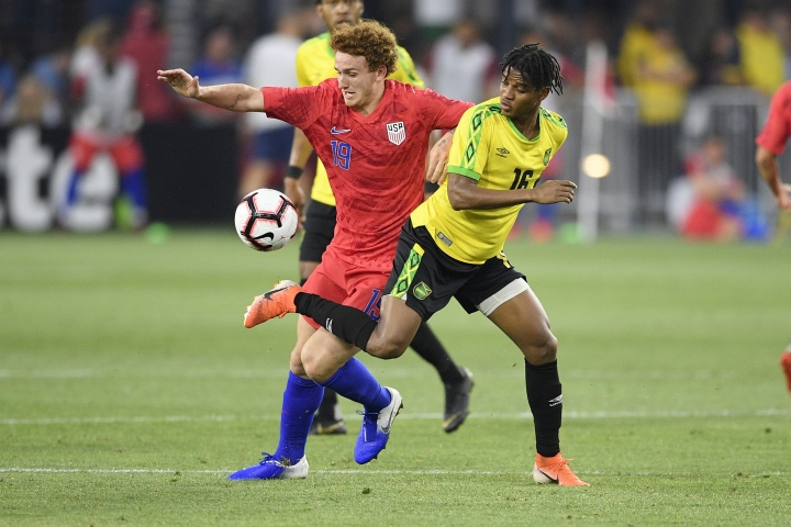 U.S. forward Josh Sargent (19) battles for the ball against Jamaica midfielder Peter Vassell (16) during the second half of an international friendly soccer match Wednesday, June 5, 2019, in Washington. Jamaica won 1-0. (AP Photo/Nick Wass)