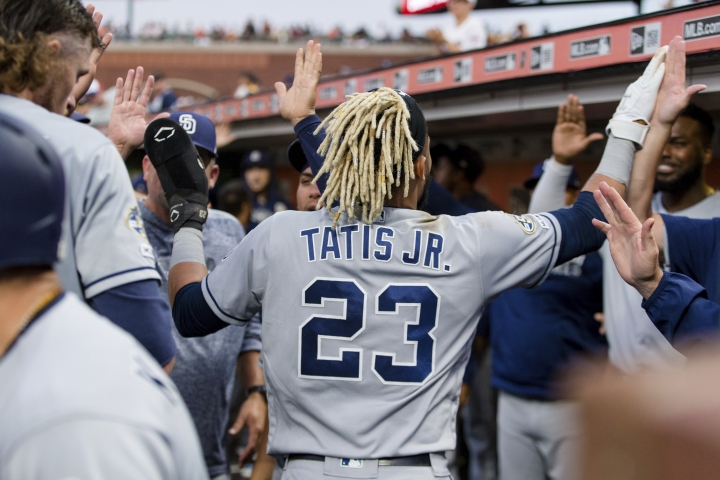 San Diego Padres' Fernando Tatis Jr. (23) is congratulated in the dugout after scoring against the San Francisco Giants during the fifth inning of a baseball game Tuesday, June 11, 2019, in San Francisco. (AP Photo/John Hefti)