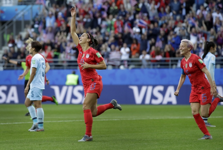 United States' Alex Morgan, left, celebrates after scoring the opening goal during the Women's World Cup Group F soccer match between United States and Thailand at the Stade Auguste-Delaune in Reims, France, Tuesday, June 11, 2019. (AP Photo/Alessandra Tarantino)