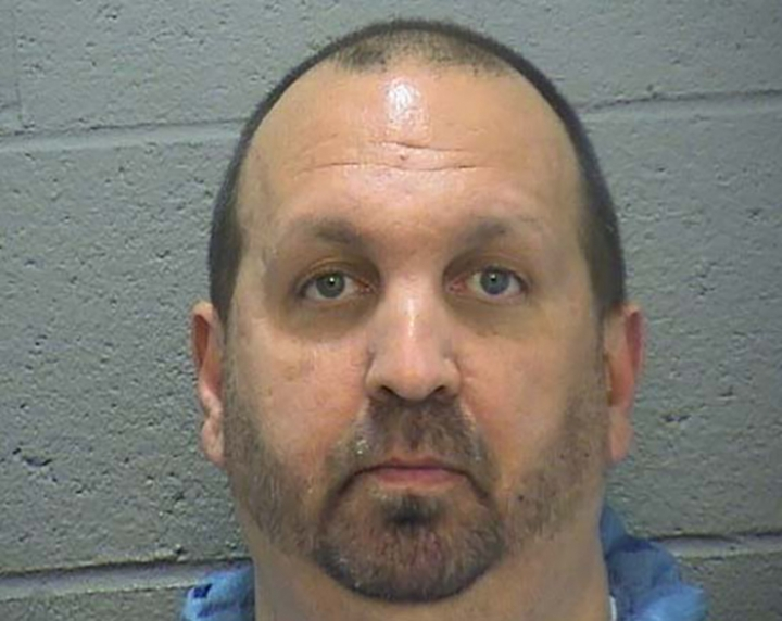FILE - This undated photo provided by the Durham Sheriff's Office shows Craig Hicks. Hicks has been charged with the shooting deaths of three young Muslims in January 2015 in Raleigh, N.C. Hicks is expected to enter a plea Wednesday, June 12, 2019, more than four years after the slayings, which the victims' families blamed on bigotry (Durham Sheriff's Office via AP, File)