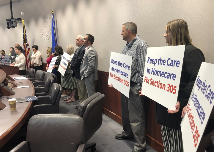 Representatives of a Connecticut-based homecare agencies appear at the Legislative Office Building in Hartford, Conn., Wednesday, June 12, 2019, to call on Democratic Gov. Ned Lamont to veto part of the new state budget. The Coalition to Make Homecare Better said a provision barring non-compete agreements would be harmful to the agencies and their clients. (AP Photo/Susan Haigh)