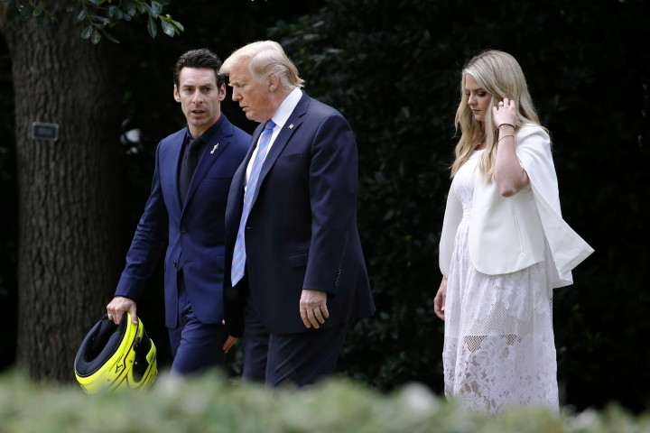 President Donald Trump walks with driver Simon Pagenaud, left, and Pagenaud's fiancee, Hailey McDermott, to the South Lawn at the White House, Monday, June 10, 2019, in Washington for an event to honor Team Penske for the 2019 Indianapolis 500 win. (AP Photo/Patrick Semansky)